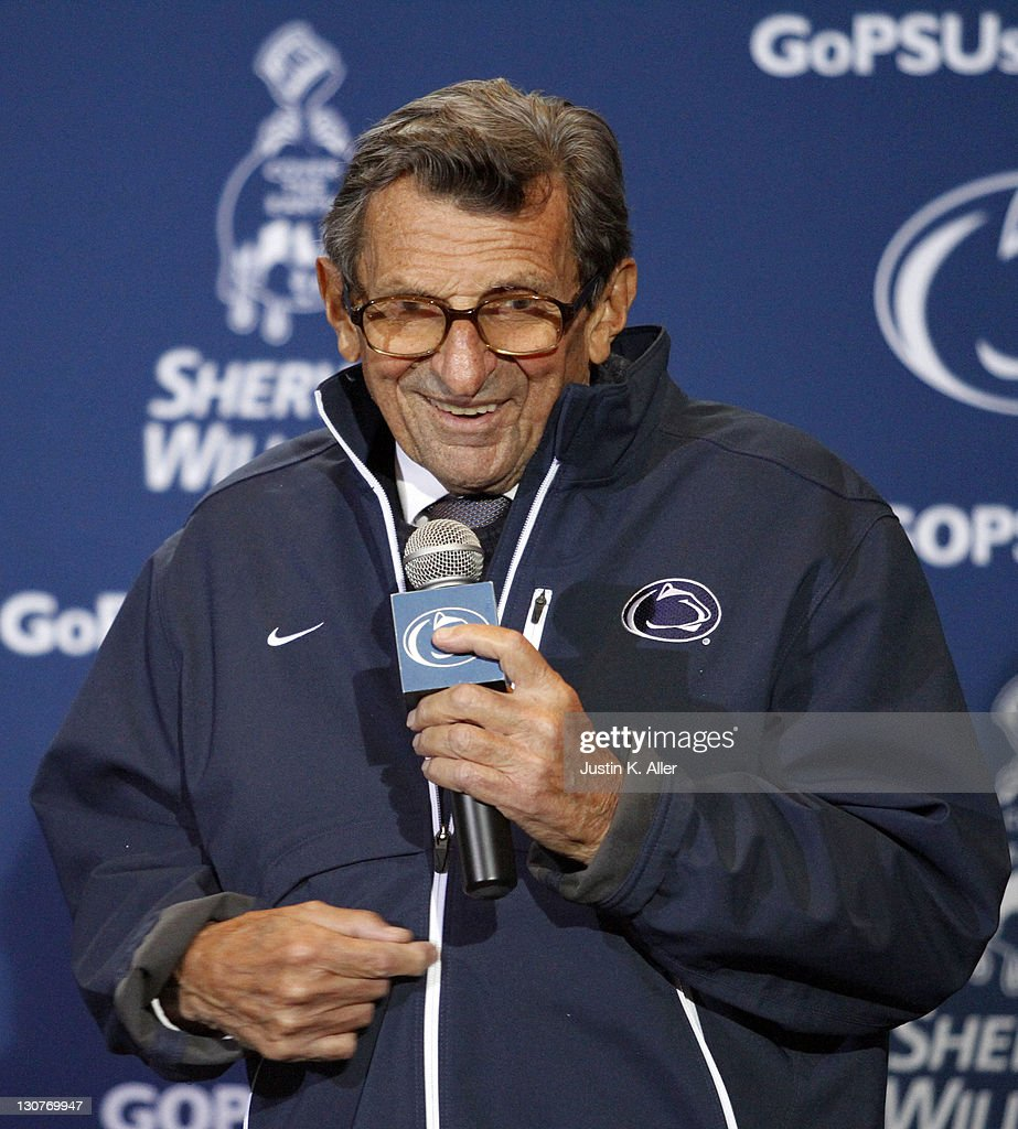 <a gi-track='captionPersonalityLinkClicked' href=/galleries/search?phrase=Joe+Paterno&family=editorial&specificpeople=623059 ng-click='$event.stopPropagation()'>Joe Paterno</a> receives a plaque celebrating his 409th career win after the game against the Illinois Fighting Illini on October 29, 2011 at Beaver Stadium in State College, Pennsylvania. The Nittany Lions defeated the Fighting Illini 10-7.