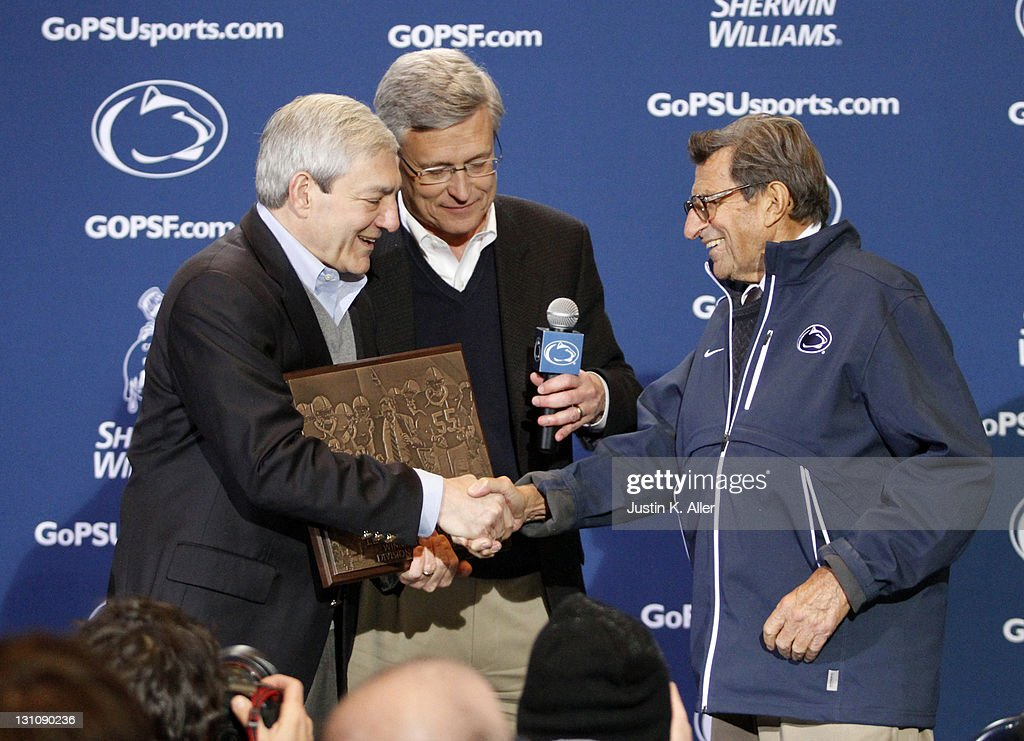 Joe Paterno receives a plaque celebrating his 409th career win after the game against the Illinois Fighting Illini on October 29, 2011 at Beaver Stadium in State College, Pennsylvania. The Nittany Lions defeated the Fighting Illini 10-7.
