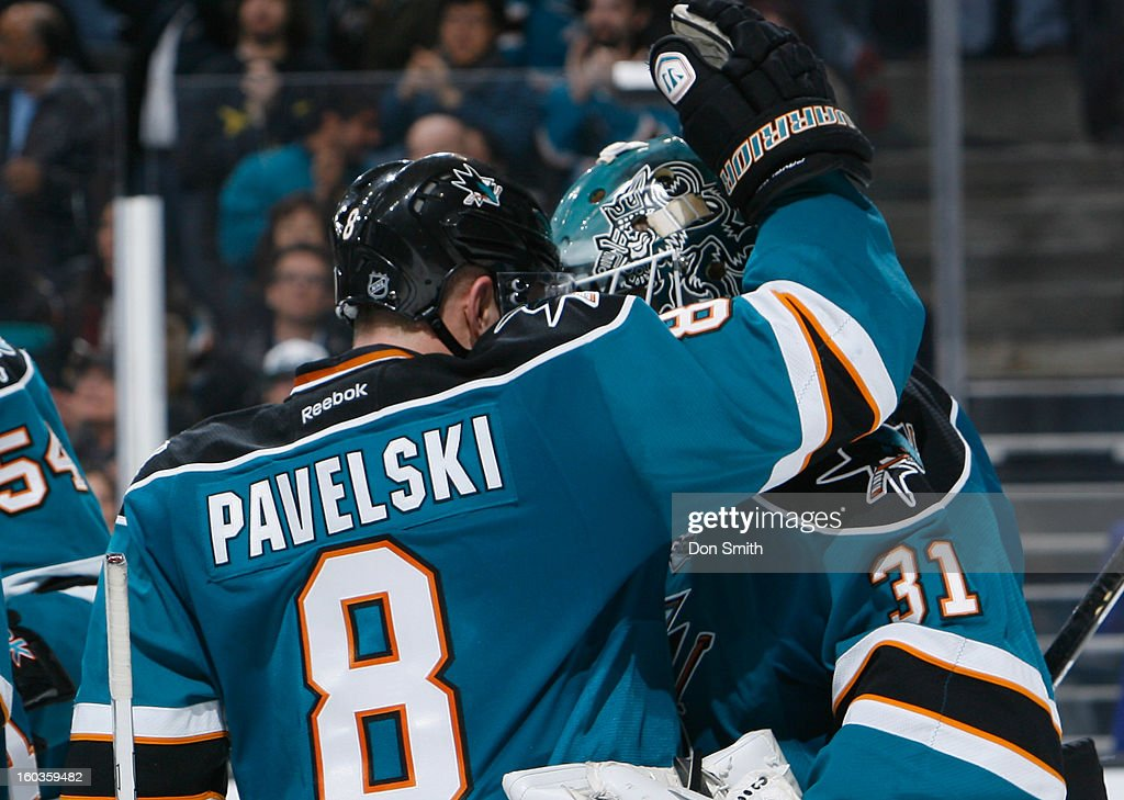 Joe Pavelski #8 and Antti Niemi #31 of the San Jose Sharks celebrate a victory against the Anaheim Ducks during an NHL game on January 29, 2013 at HP Pavilion in San Jose, California.