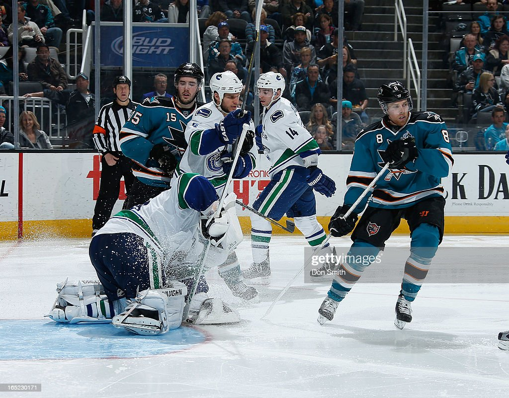 <a gi-track='captionPersonalityLinkClicked' href=/galleries/search?phrase=Joe+Pavelski&family=editorial&specificpeople=687042 ng-click='$event.stopPropagation()'>Joe Pavelski</a> #8 and <a gi-track='captionPersonalityLinkClicked' href=/galleries/search?phrase=James+Sheppard&family=editorial&specificpeople=537966 ng-click='$event.stopPropagation()'>James Sheppard</a> #15 of the San Jose Sharks looks for a rebound against <a gi-track='captionPersonalityLinkClicked' href=/galleries/search?phrase=Cory+Schneider&family=editorial&specificpeople=696908 ng-click='$event.stopPropagation()'>Cory Schneider</a> #35, <a gi-track='captionPersonalityLinkClicked' href=/galleries/search?phrase=Kevin+Bieksa&family=editorial&specificpeople=688792 ng-click='$event.stopPropagation()'>Kevin Bieksa</a> #3 and <a gi-track='captionPersonalityLinkClicked' href=/galleries/search?phrase=Alexandre+Burrows&family=editorial&specificpeople=592489 ng-click='$event.stopPropagation()'>Alexandre Burrows</a> #14 of the Vancouver Canucks during an NHL game on April 1, 2013 at HP Pavilion in San Jose, California.
