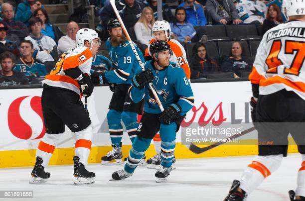 Joe Pavelski and Joe Thornton of the San Jose Sharks along with Ivan Provorov and Scott Laughton of the Philadelphia Flyers skate at SAP Center at...