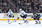 Joe Pavelski and Justin Braun of the San Jose Sharks skate against Slava Voynov of the Los Angeles Kings in Game Three of the First Round of the 2014...