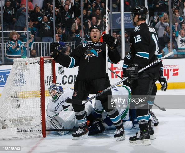 Joe Pavelski and Patrick Marleau of the San Jose Sharks celebrate Pavelski's goal against Cory Schneider of the Vancouver Canucks in Game Four of the...