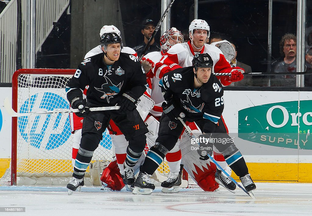 <a gi-track='captionPersonalityLinkClicked' href=/galleries/search?phrase=Joe+Pavelski&family=editorial&specificpeople=687042 ng-click='$event.stopPropagation()'>Joe Pavelski</a> #8 and <a gi-track='captionPersonalityLinkClicked' href=/galleries/search?phrase=Ryane+Clowe&family=editorial&specificpeople=736658 ng-click='$event.stopPropagation()'>Ryane Clowe</a> #29 of the San Jose Sharks create traffic in front of the net against <a gi-track='captionPersonalityLinkClicked' href=/galleries/search?phrase=Jimmy+Howard&family=editorial&specificpeople=2118637 ng-click='$event.stopPropagation()'>Jimmy Howard</a> #35, Brendan Smith #2, and <a gi-track='captionPersonalityLinkClicked' href=/galleries/search?phrase=Daniel+Cleary&family=editorial&specificpeople=220490 ng-click='$event.stopPropagation()'>Daniel Cleary</a> #11 of the Detroit Red Wings during an NHL game on March 28, 2013 at HP Pavilion in San Jose, California.
