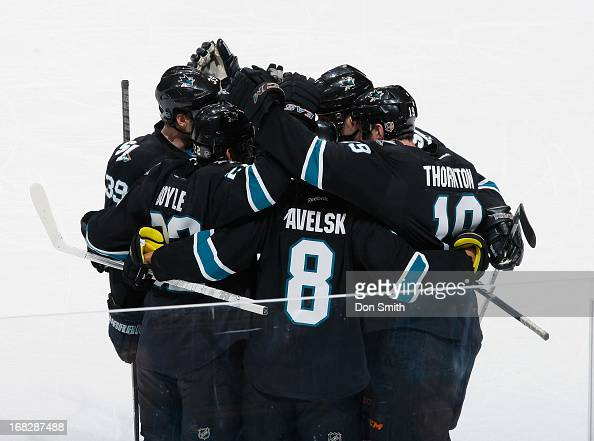 Joe Pavelski Dan Boyle Logan Couture and Joe Thornton of the San Jose Sharks celebrate Pavelski's goal against the Vancouver Canucks in Game Four of...