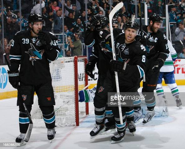 Joe Pavelski Logan Couture and Joe Thornton of the San Jose Sharks celebrate Pavelski's goal against the Vancouver Canucks in Game Four of the...