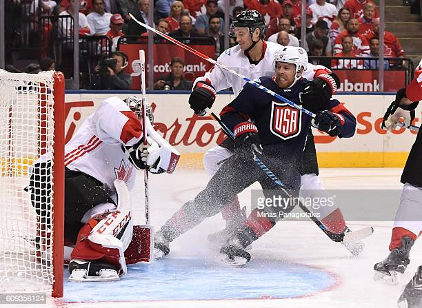 Joe Pavelski of Team USA battles for position with Jay Bouwmeester battle for position in front of Carey Price of Team Canada during the World Cup of...
