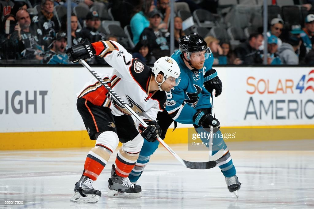 Joe Pavelski #8 of the San Jose Sharks and Andrew Cogliano #7 of the Anaheim Ducks ready themselves at SAP Center at San Jose on March 18, 2017 in San Jose, California.
