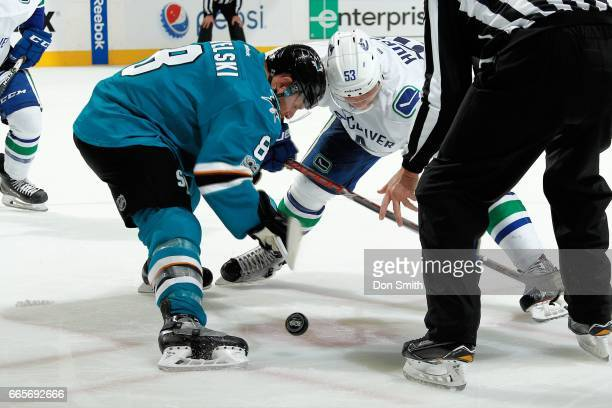 Joe Pavelski of the San Jose Sharks and Bo Horvat of the Vancouver Canucks face off during a NHL game at SAP Center at San Jose on April 4 2017 in...