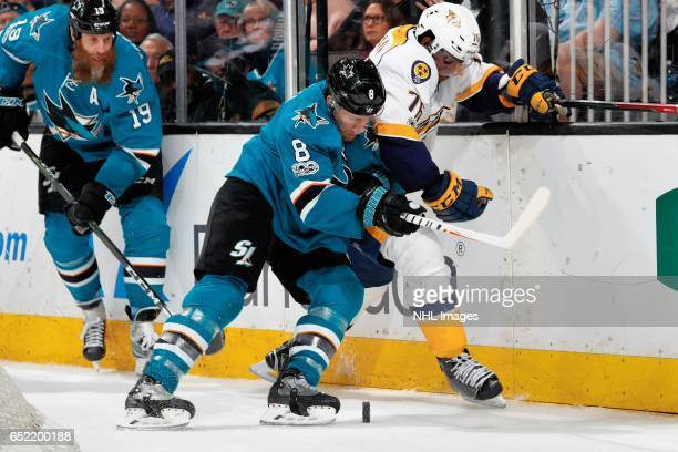 Joe Pavelski of the San Jose Sharks and PK Subban of the Nashville Predators battle for the puck along the boards at SAP Center at San Jose on March...