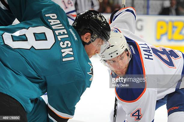 Joe Pavelski of the San Jose Sharks and Taylor Hall of the Edmonton Oilers line up for a faceoff during the game on April 9 2015 at Rexall Place in...