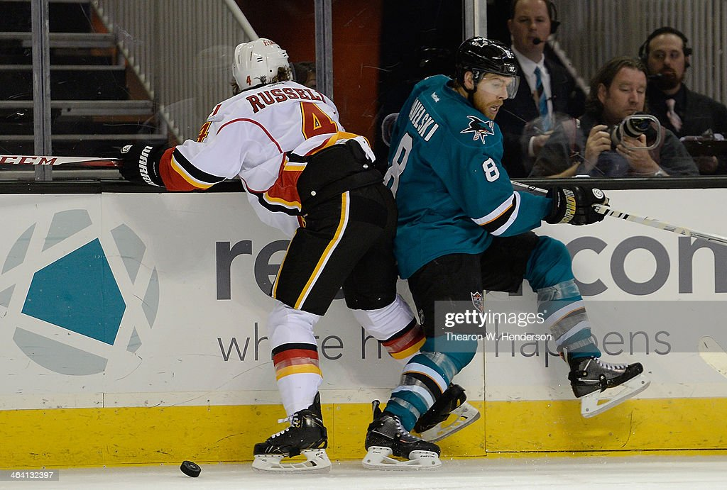 <a gi-track='captionPersonalityLinkClicked' href=/galleries/search?phrase=Joe+Pavelski&family=editorial&specificpeople=687042 ng-click='$event.stopPropagation()'>Joe Pavelski</a> #8 of the San Jose Sharks avoids colliding with <a gi-track='captionPersonalityLinkClicked' href=/galleries/search?phrase=Kris+Russell&family=editorial&specificpeople=879805 ng-click='$event.stopPropagation()'>Kris Russell</a> #4 of the Calgary Flames during the second period at SAP Center on January 20, 2014 in San Jose, California. The Sharks won the game 3-2.