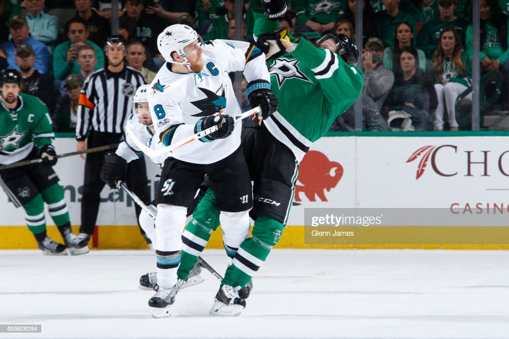 Joe Pavelski #8 of the San Jose Sharks battles for position against John Klingberg #3 of the Dallas Stars at the American Airlines Center on March 20, 2017 in Dallas, Texas.