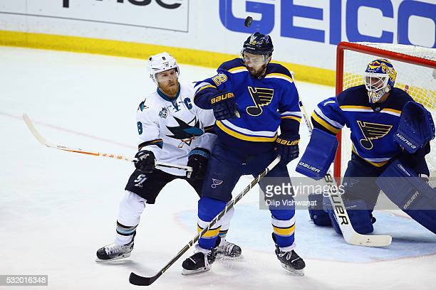 Joe Pavelski of the San Jose Sharks battles for the puck with Kevin Shattenkirk of the St Louis Blues during the second period in Game Two of the...