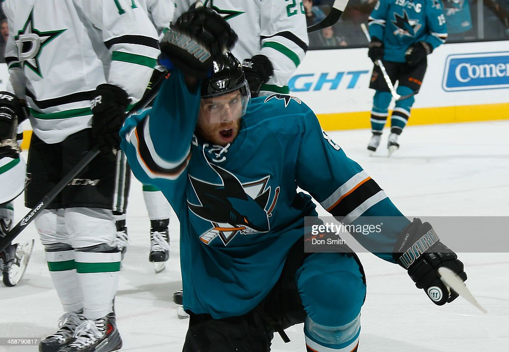 Joe Pavelski #8 of the San Jose Sharks celebrates after his goal against the Dallas Stars during an NHL game on December 21, 2013 at SAP Center in San Jose, California.