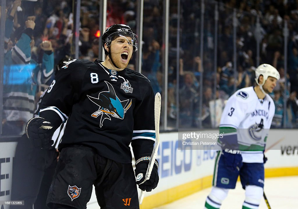 Joe Pavelski #8 of the San Jose Sharks celebrates after scoring a second period goal ahead of Kevin Bieksa #3 of the Vancouver Canucks in Game Three of the Western Conference Quarterfinals during the 2013 NHL Stanley Cup Playoffs at HP Pavilion on May 5, 2013 in San Jose, California.