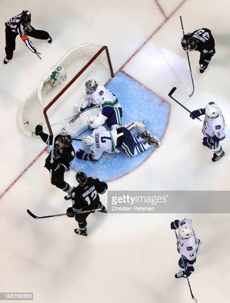 Joe Pavelski of the San Jose Sharks celebrates alongside Patrick Marleau and Logan Couture after scoring a third period power play goal past...
