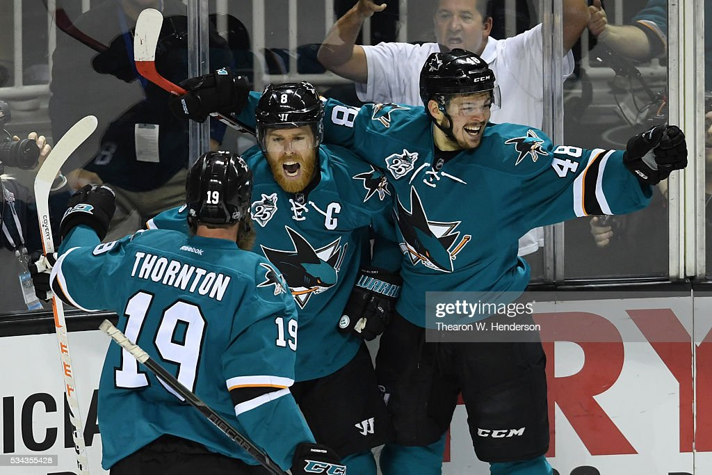 Joe Pavelski of the San Jose Sharks celebrates his goal against the St Louis Blues with Joe Thornton and Tomas Hertl in Game Six of the Western...