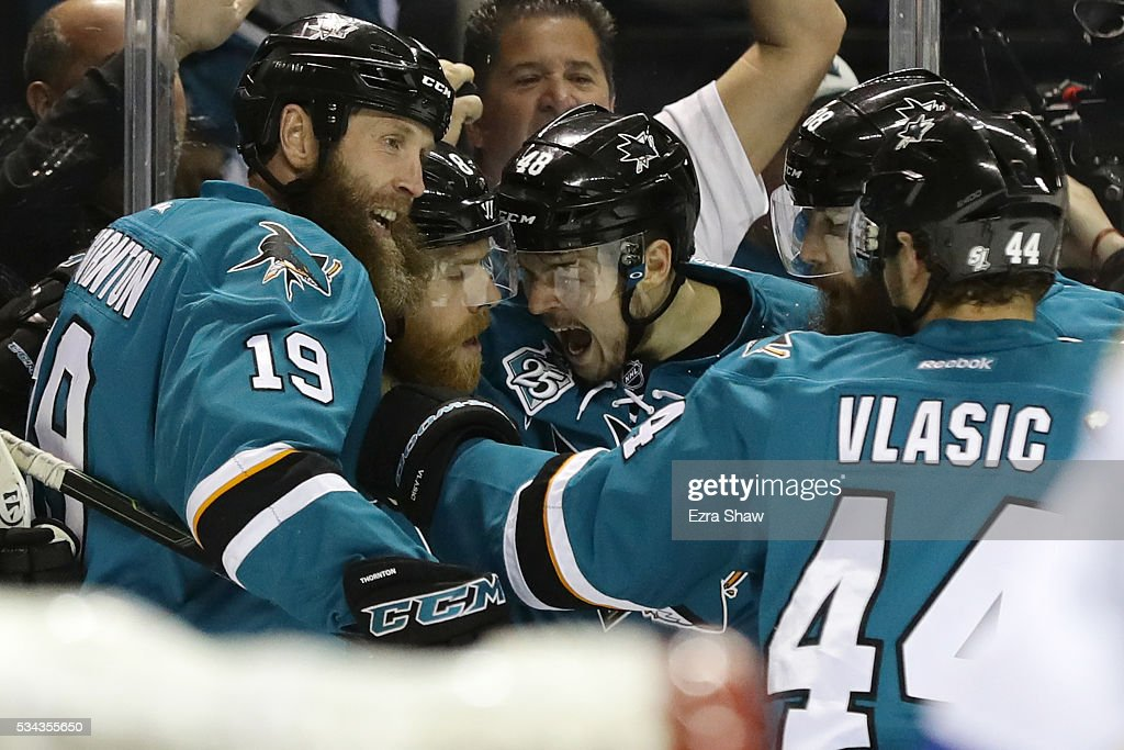 <a gi-track='captionPersonalityLinkClicked' href=/galleries/search?phrase=Joe+Pavelski&family=editorial&specificpeople=687042 ng-click='$event.stopPropagation()'>Joe Pavelski</a> #8 of the San Jose Sharks celebrates his goal against the St. Louis Blues with <a gi-track='captionPersonalityLinkClicked' href=/galleries/search?phrase=Joe+Thornton&family=editorial&specificpeople=201829 ng-click='$event.stopPropagation()'>Joe Thornton</a> #19, <a gi-track='captionPersonalityLinkClicked' href=/galleries/search?phrase=Brent+Burns&family=editorial&specificpeople=212883 ng-click='$event.stopPropagation()'>Brent Burns</a> #88, <a gi-track='captionPersonalityLinkClicked' href=/galleries/search?phrase=Tomas+Hertl&family=editorial&specificpeople=8761287 ng-click='$event.stopPropagation()'>Tomas Hertl</a> #48 and <a gi-track='captionPersonalityLinkClicked' href=/galleries/search?phrase=Marc-Edouard+Vlasic&family=editorial&specificpeople=880807 ng-click='$event.stopPropagation()'>Marc-Edouard Vlasic</a> #44 in Game Six of the Western Conference Final during the 2016 NHL Stanley Cup Playoffs at SAP Center on May 25, 2016 in San Jose, California.