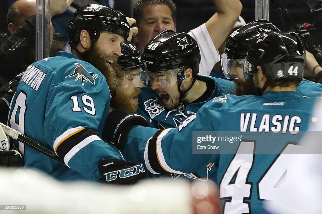 Joe Pavelski of the San Jose Sharks celebrates his goal against the St Louis Blues with Joe Thornton Brent Burns Tomas Hertl and MarcEdouard Vlasic...