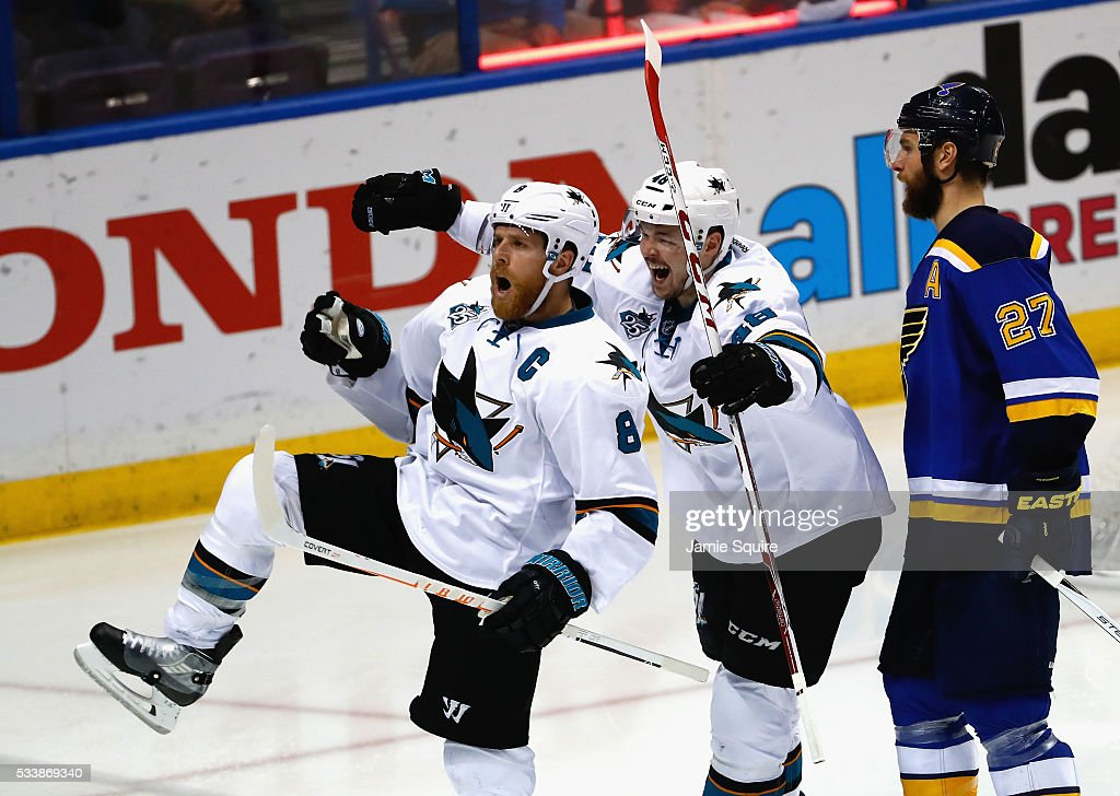 Joe Pavelski of the San Jose Sharks celebrates with Tomas Hertl after scoring a third period goal against the St Louis Blues in Game Five of the...
