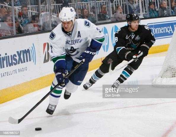 Joe Pavelski of the San Jose Sharks chases after Kevin Bieksa of the Vancouver Canucks in Game Four of the Western Conference Quarterfinals during...