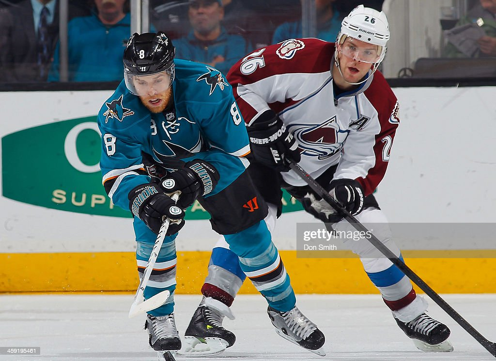 <a gi-track='captionPersonalityLinkClicked' href=/galleries/search?phrase=Joe+Pavelski&family=editorial&specificpeople=687042 ng-click='$event.stopPropagation()'>Joe Pavelski</a> #8 of the San Jose Sharks collects the pass against Paul Stastny #26 of the Colorado Avalanche during an NHL game on December 23, 2013 at SAP Center in San Jose, California.