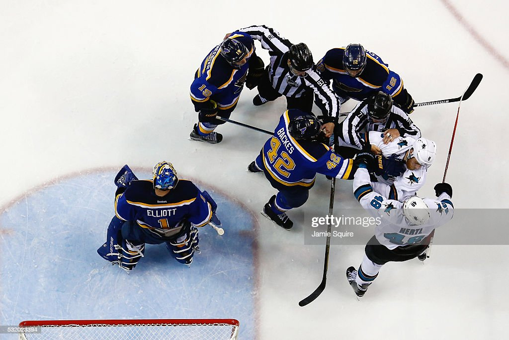 Joe Pavelski #8 of the San Jose Sharks fights David Backes #42 of the St. Louis Blues during the third period in Game Two of the Western Conference Final during the 2016 NHL Stanley Cup Playoffs at Scottrade Center on May 17, 2016 in St Louis, Missouri.