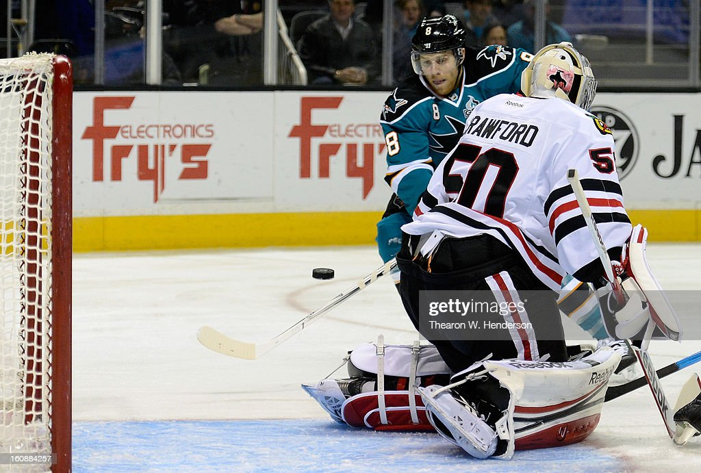 Joe Pavelski #8 of the San Jose Sharks gets his shot past goalkeeper Corey Crawford #50 of the Chicago Blackhawks to score in the first period at HP Pavilion on February 5, 2013 in San Jose, California.