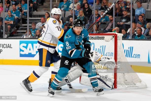 Joe Pavelski of the San Jose Sharks gets in front of Juuse Saros and PK Subban of the Nashville Predators during a NHL game at SAP Center at San Jose...