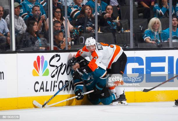 Joe Pavelski of the San Jose Sharks gets tangled up with Ivan Provorov of the Philadelphia Flyers during a NHL game at SAP Center at San Jose on...