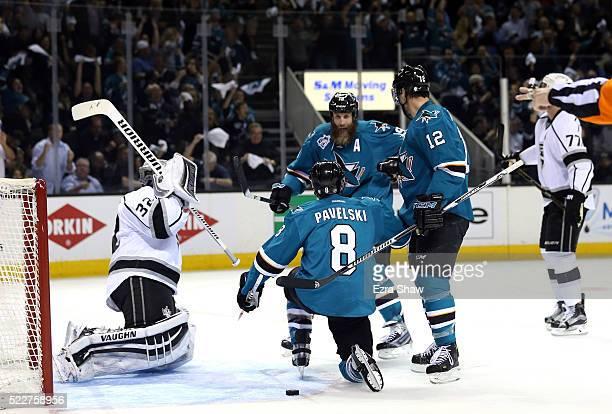 Joe Pavelski of the San Jose Sharks is congratulated by Joe Thornton and Patrick Marleau of the San Jose Sharks after he scored a goal on Jonathan...