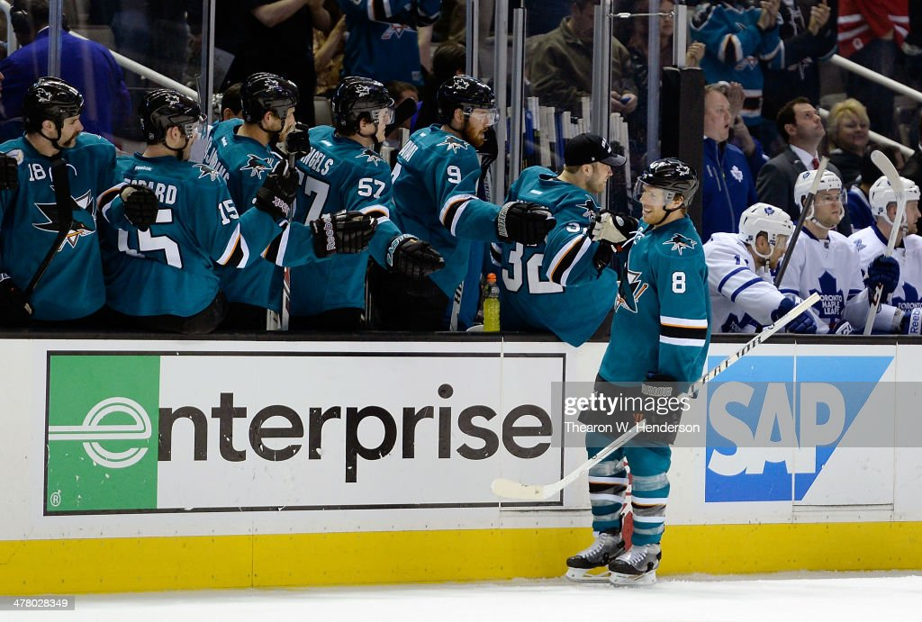 <a gi-track='captionPersonalityLinkClicked' href=/galleries/search?phrase=Joe+Pavelski&family=editorial&specificpeople=687042 ng-click='$event.stopPropagation()'>Joe Pavelski</a> #8 of the San Jose Sharks is congratulated by teammates after scoring a goal against the Toronto Maple Leafs during the third period at SAP Center on March 11, 2014 in San Jose, California. The Sharks won the game 6-2.