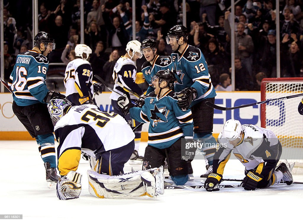 Joe Pavelski of the San Jose Sharks is congratulated by teammates Devin Setoguchi Patrick Marleau and MarcEdouard Vlasic after he made a goal on Ryan...