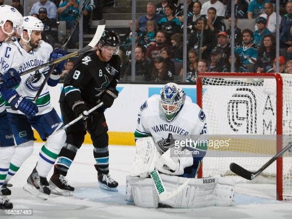 Joe Pavelski of the San Jose Sharks looks for a rebound against Cory Schneider of the Vancouver Canucks in Game Four of the Western Conference...