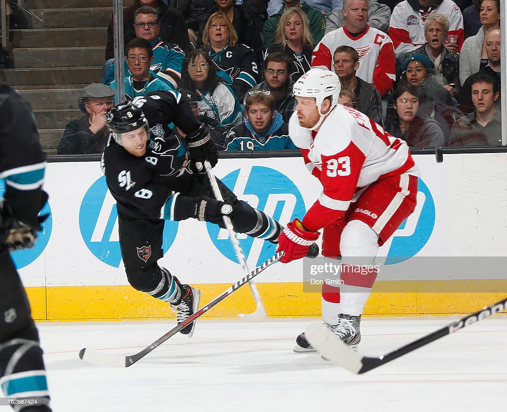 <a gi-track='captionPersonalityLinkClicked' href=/galleries/search?phrase=Joe+Pavelski&family=editorial&specificpeople=687042 ng-click='$event.stopPropagation()'>Joe Pavelski</a> #8 of the San Jose Sharks passes the puck against <a gi-track='captionPersonalityLinkClicked' href=/galleries/search?phrase=Johan+Franzen&family=editorial&specificpeople=624356 ng-click='$event.stopPropagation()'>Johan Franzen</a> #93 of the Detroit Red Wings during an NHL game on February 28, 2013 at HP Pavilion in San Jose, California.