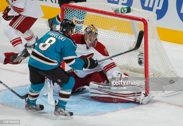 Joe Pavelski of the San Jose Sharks scores a firstperiod goal against Mike Smith of the Phoenix Coyotes during an NHL game on October 8 2011 at HP...