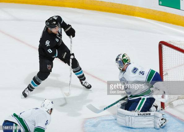 Joe Pavelski of the San Jose Sharks scores a goal against Cory Schneider of the Vancouver Canucks in Game One of the Western Conference Quarterfinals...