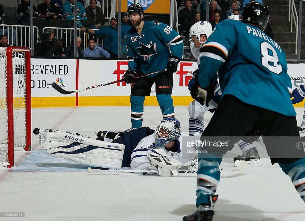 <a gi-track='captionPersonalityLinkClicked' href=/galleries/search?phrase=Joe+Pavelski&family=editorial&specificpeople=687042 ng-click='$event.stopPropagation()'>Joe Pavelski</a> #8 of the San Jose Sharks scores a goal as teammate <a gi-track='captionPersonalityLinkClicked' href=/galleries/search?phrase=Brent+Burns&family=editorial&specificpeople=212883 ng-click='$event.stopPropagation()'>Brent Burns</a> #88 watches on against James Reimer #34 of the Toronto Maple Leafs during an NHL game on March 11, 2014 at SAP Center in San Jose, California.