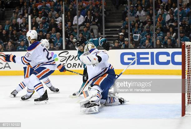 Joe Pavelski of the San Jose Sharks scores getting his shot past goalie Laurent Brossoit of the Edmonton Oilers during the second period in Game Four...