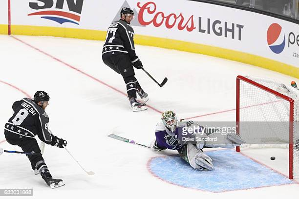Joe Pavelski of the San Jose Sharks scores on a drop pass from Jeff Carter of the Los Angeles Kings past Devan Dubnyk of the Minnesota Wild during...