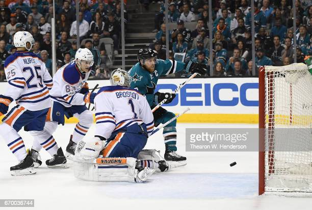 Joe Pavelski of the San Jose Sharks scores past goalie Laurent Brossoit of the Edmonton Oilers during the second period in Game Four of the Western...