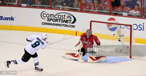 Joe Pavelski of the San Jose Sharks scores the game winning goal on Justin Peters of the Washington Capitals during the Sharks 65 shootout win at...