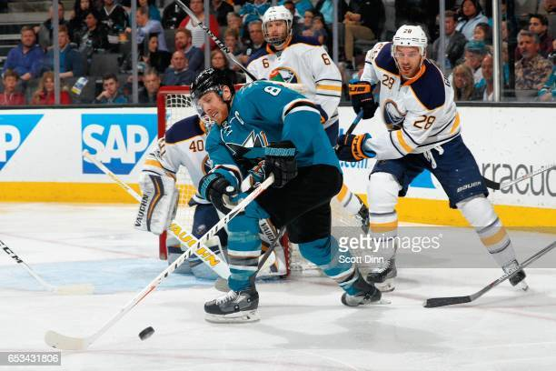 Joe Pavelski of the San Jose Sharks scrambles for the puck as Robin Lehner Cody Franson and Zemgus Girgensons of the Buffalo Sabres defend at SAP...