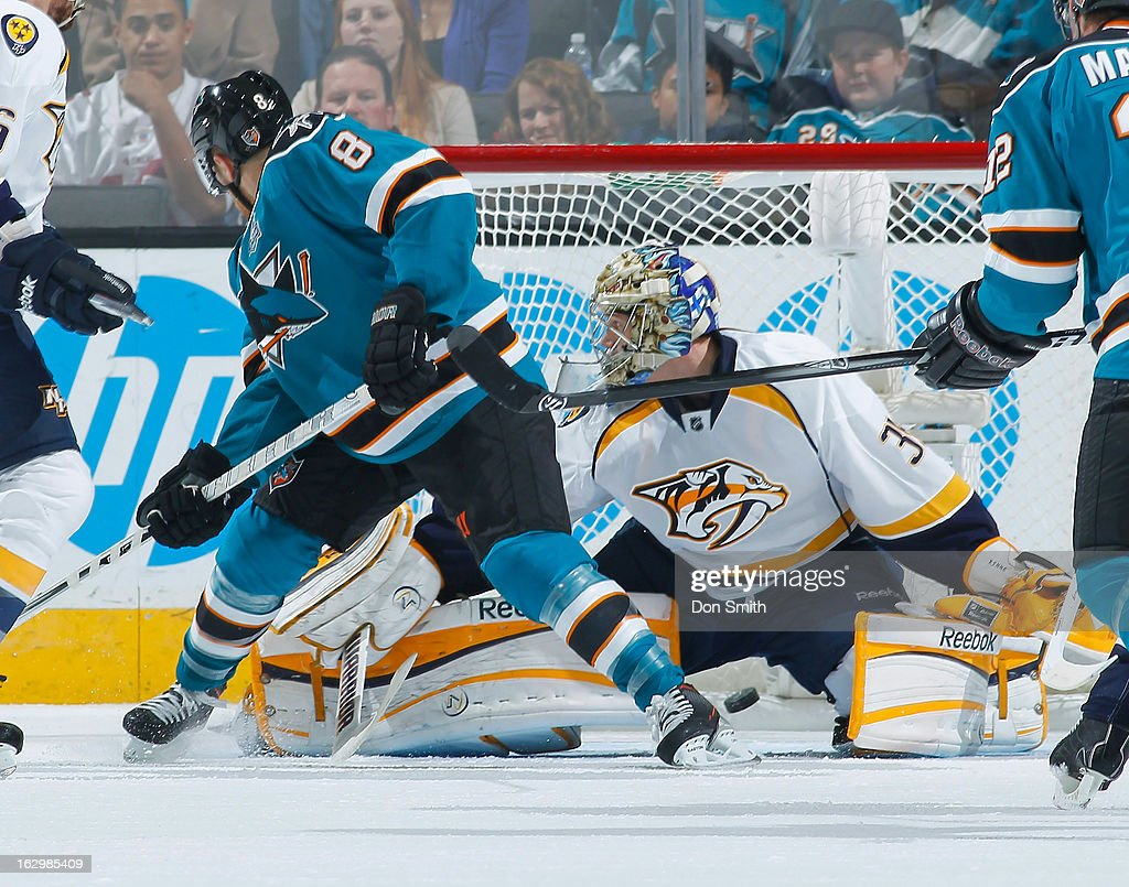 <a gi-track='captionPersonalityLinkClicked' href=/galleries/search?phrase=Joe+Pavelski&family=editorial&specificpeople=687042 ng-click='$event.stopPropagation()'>Joe Pavelski</a> #8 of the San Jose Sharks sets up a screen as watches as Dan Boyle's shot goes into the net against <a gi-track='captionPersonalityLinkClicked' href=/galleries/search?phrase=Pekka+Rinne&family=editorial&specificpeople=2118342 ng-click='$event.stopPropagation()'>Pekka Rinne</a> #35 of the Nashville Predators during an NHL game on March 2, 2013 at HP Pavilion in San Jose, California.