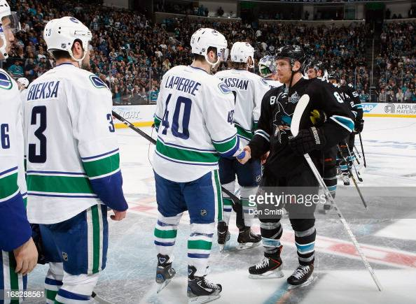 Joe Pavelski of the San Jose Sharks shakes the hand of Maxim Lapierre of the Vancouver Canucks in Game Four of the Western Conference Quarterfinals...