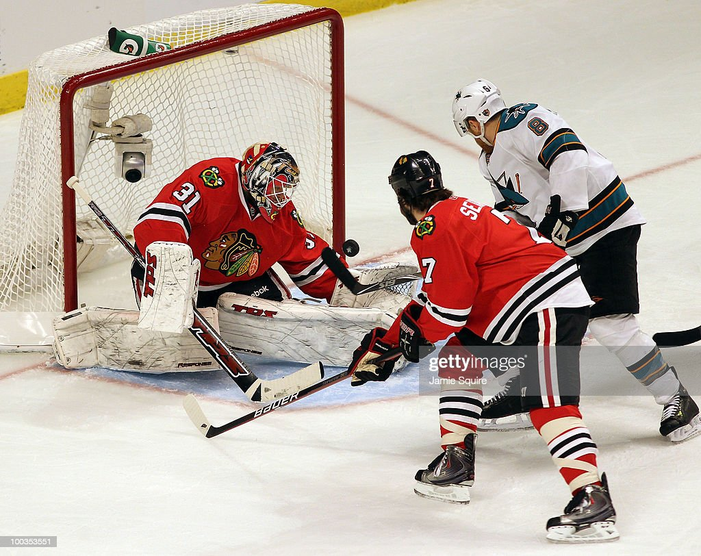 Joe Pavelski #8 of the San Jose Sharks shoots the puck as goaltender Antti Niemi #31 of the Chicago Blackhawks makes a save in the first period in Game Four of the Western Conference Finals during the 2010 NHL Stanley Cup Playoffs at the United Center on May 23, 2010 in Chicago, Illinois.