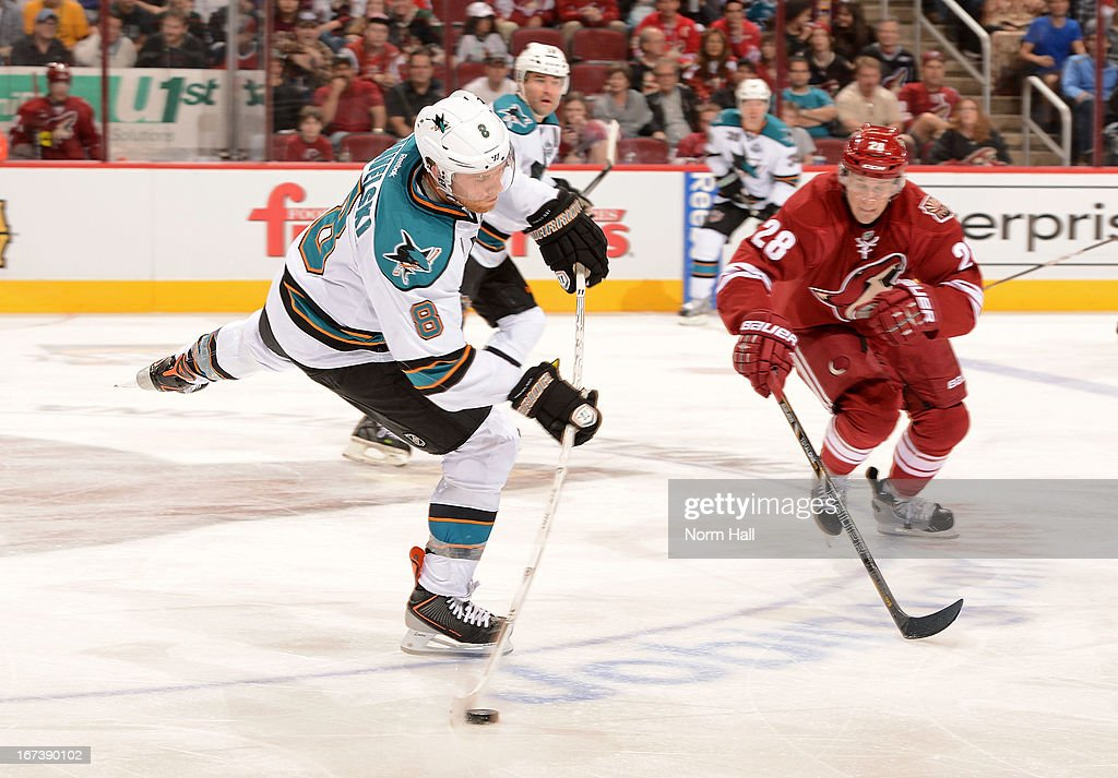 <a gi-track='captionPersonalityLinkClicked' href=/galleries/search?phrase=Joe+Pavelski&family=editorial&specificpeople=687042 ng-click='$event.stopPropagation()'>Joe Pavelski</a> #8 of the San Jose Sharks shoots the puck as <a gi-track='captionPersonalityLinkClicked' href=/galleries/search?phrase=Lauri+Korpikoski&family=editorial&specificpeople=2108074 ng-click='$event.stopPropagation()'>Lauri Korpikoski</a> #28 of the Phoenix Coyotes defends during the third period at Jobing.com Arena on April 24, 2013 in Glendale, Arizona.