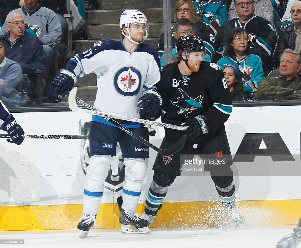 <a gi-track='captionPersonalityLinkClicked' href=/galleries/search?phrase=Joe+Pavelski&family=editorial&specificpeople=687042 ng-click='$event.stopPropagation()'>Joe Pavelski</a> #8 of the San Jose Sharks skates after the puck against <a gi-track='captionPersonalityLinkClicked' href=/galleries/search?phrase=Michael+Frolik&family=editorial&specificpeople=537965 ng-click='$event.stopPropagation()'>Michael Frolik</a> #67 of the Winnipeg Jets during an NHL game on March 27, 2014 at SAP Center in San Jose, California.