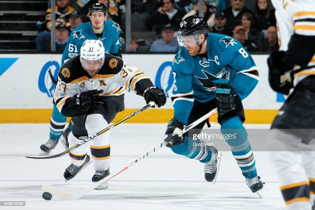 Joe Pavelski #8 of the San Jose Sharks skates against Patrice Bergeron #37 of the Boston Bruins at SAP Center at San Jose on February 19, 2017 in San Jose, California.